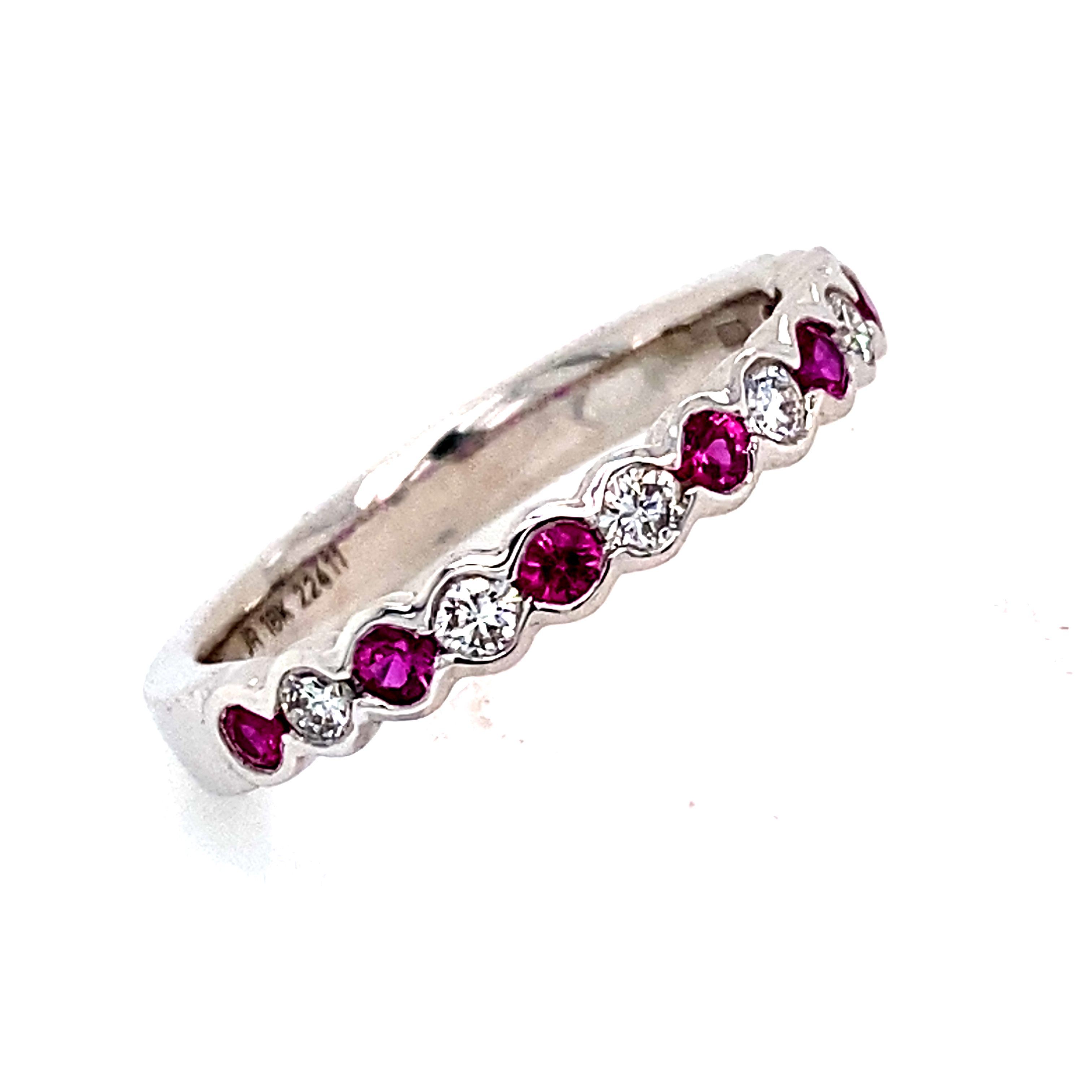 Ruby and Diamond 1/2 Eternity style ring.