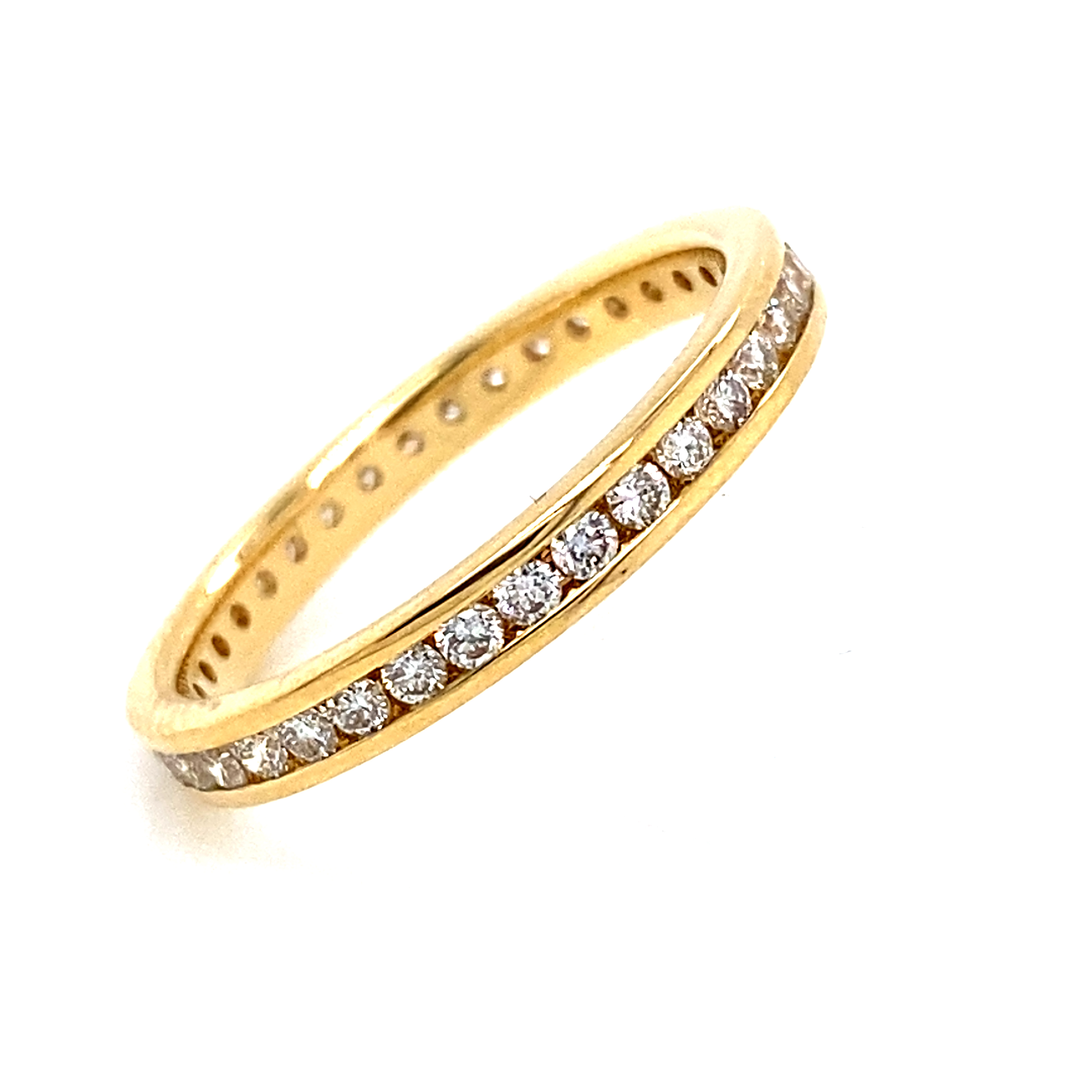 A Full 0.50 Carat Channel Set Eternity Style Ring in 18 Yellow