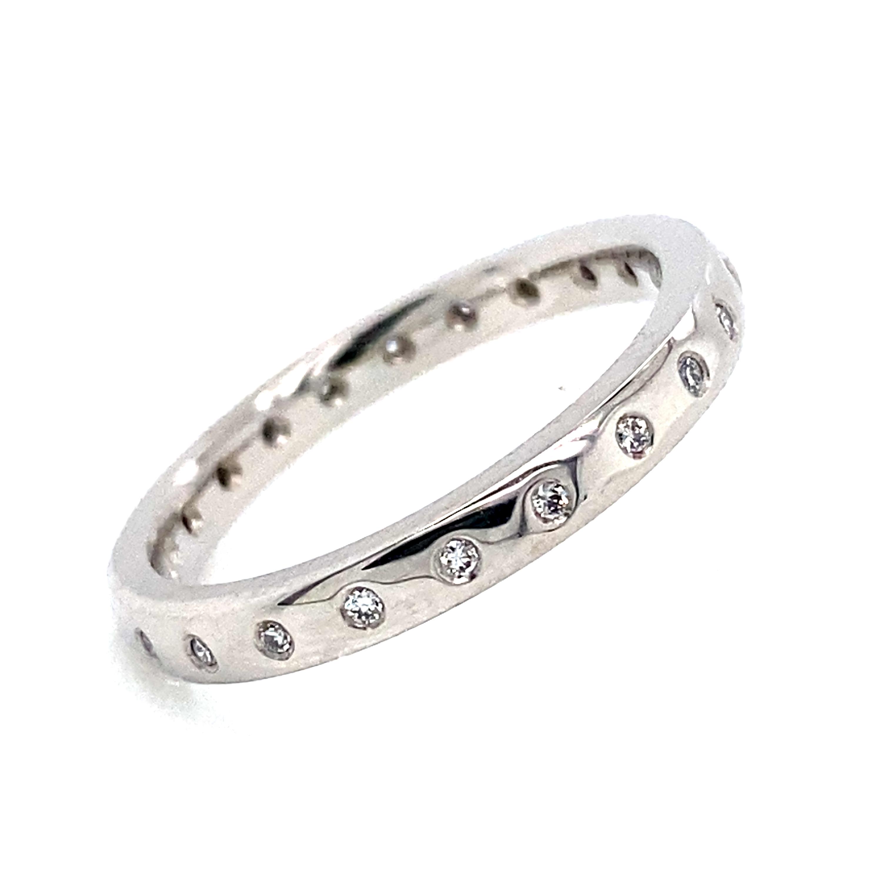 A Platinum Flush Set Band Ring.