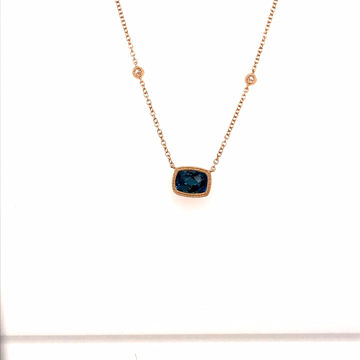 Topaz and Diamond Necklet in 9 carat yellow gold.