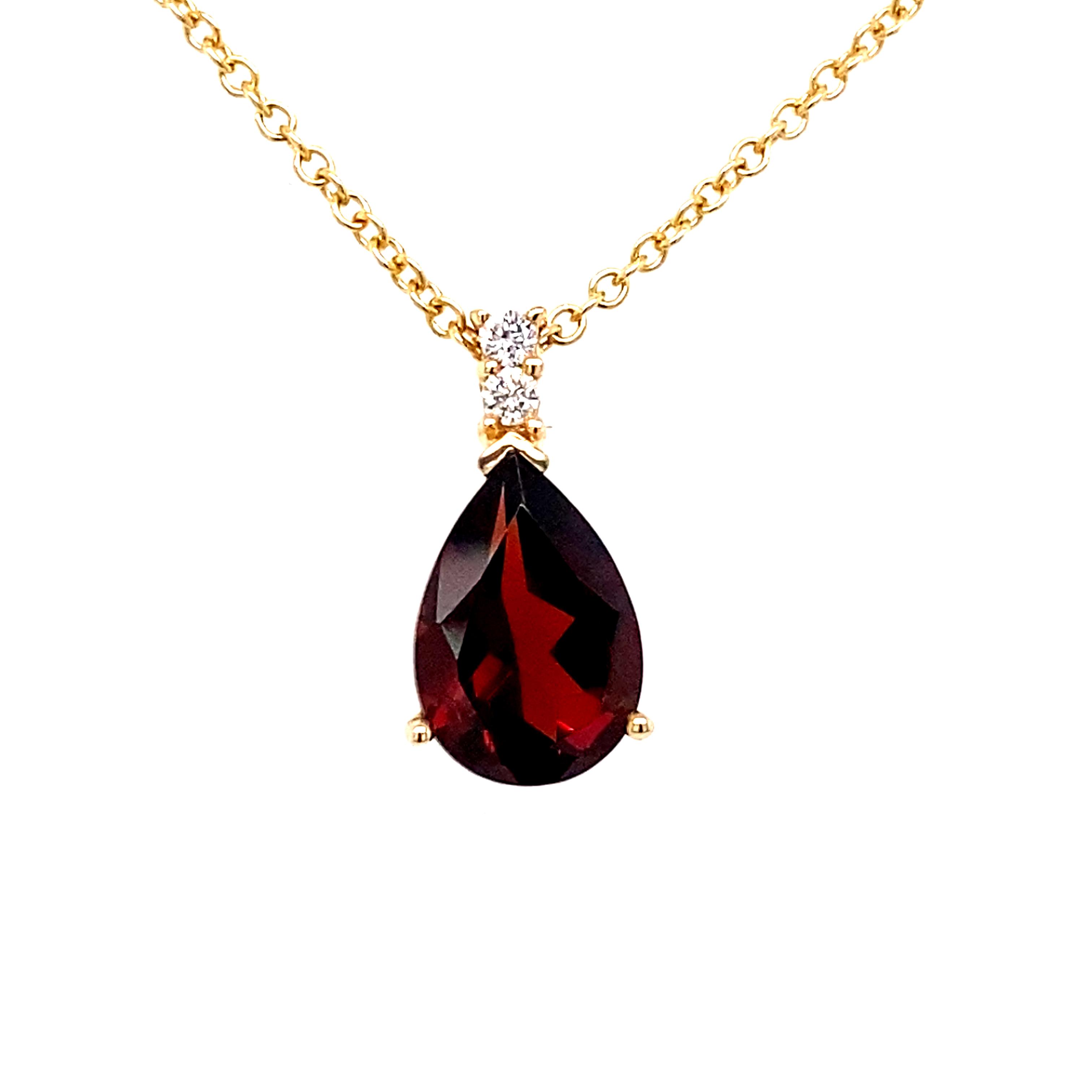 18 Carat Yellow Gold, Garnet and diamond pendant
