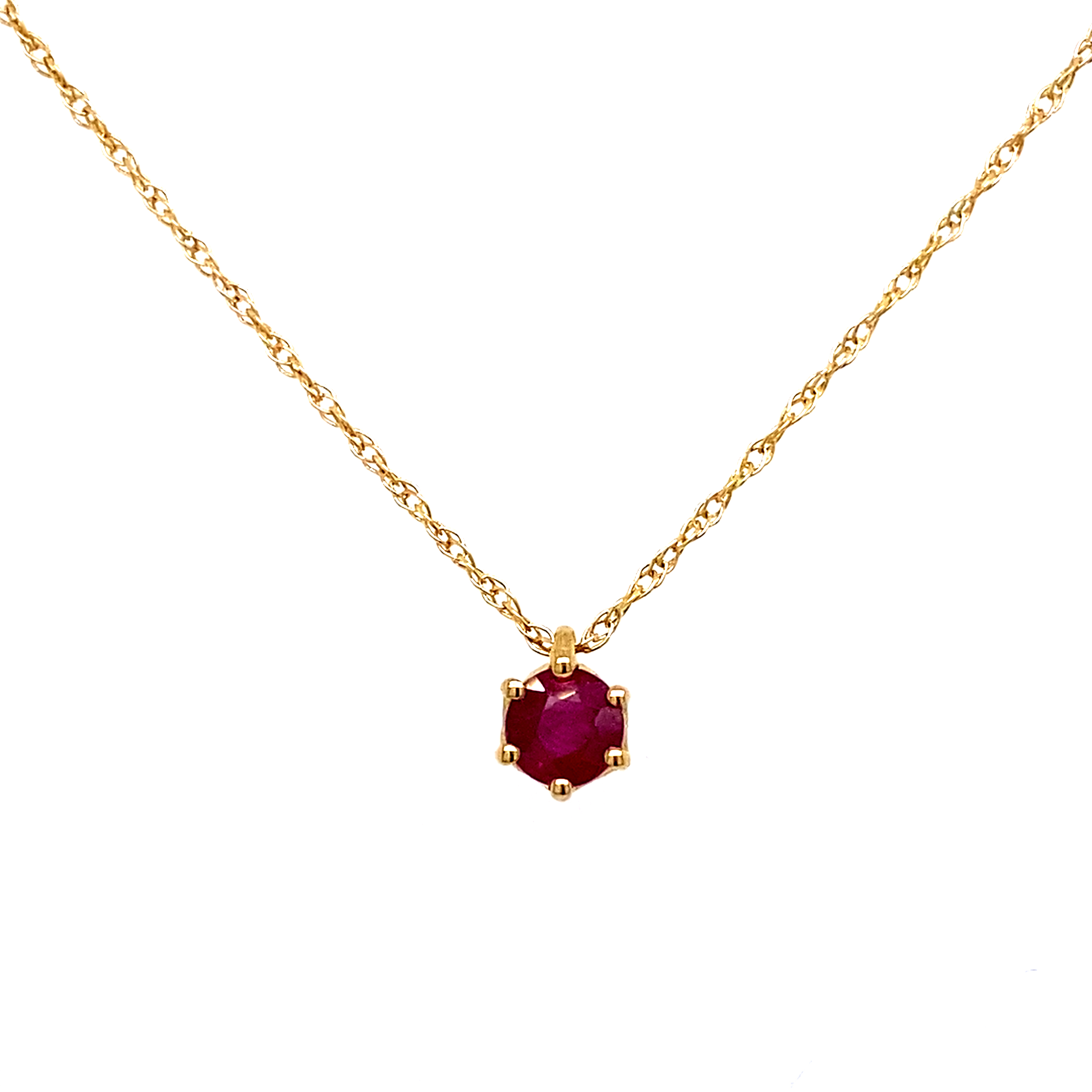 A Modern 9 Carat yellow gold ruby pendant, in a 6 claw setting.