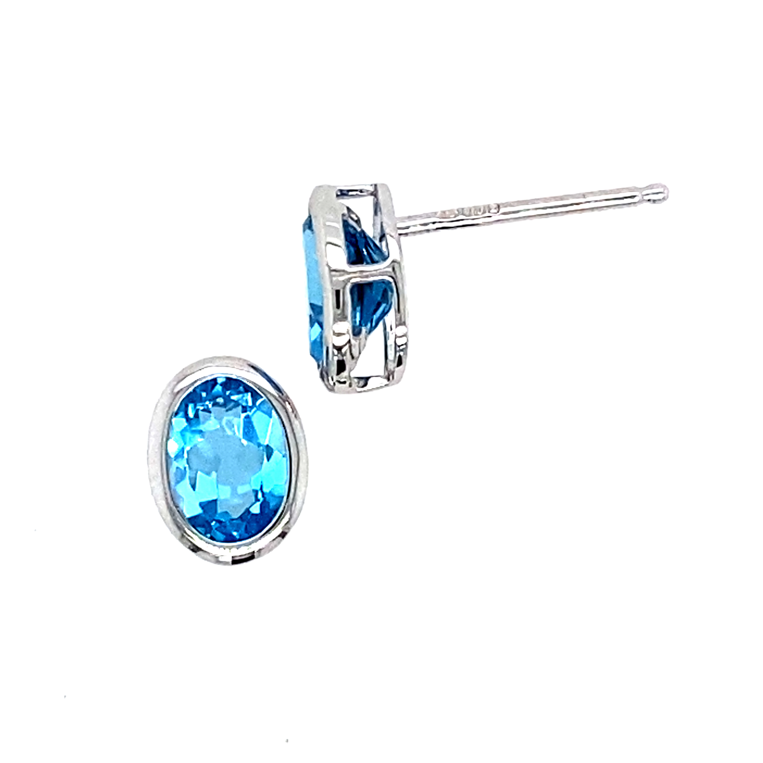 Oval blue topaz Studs in 18 carat whte gold