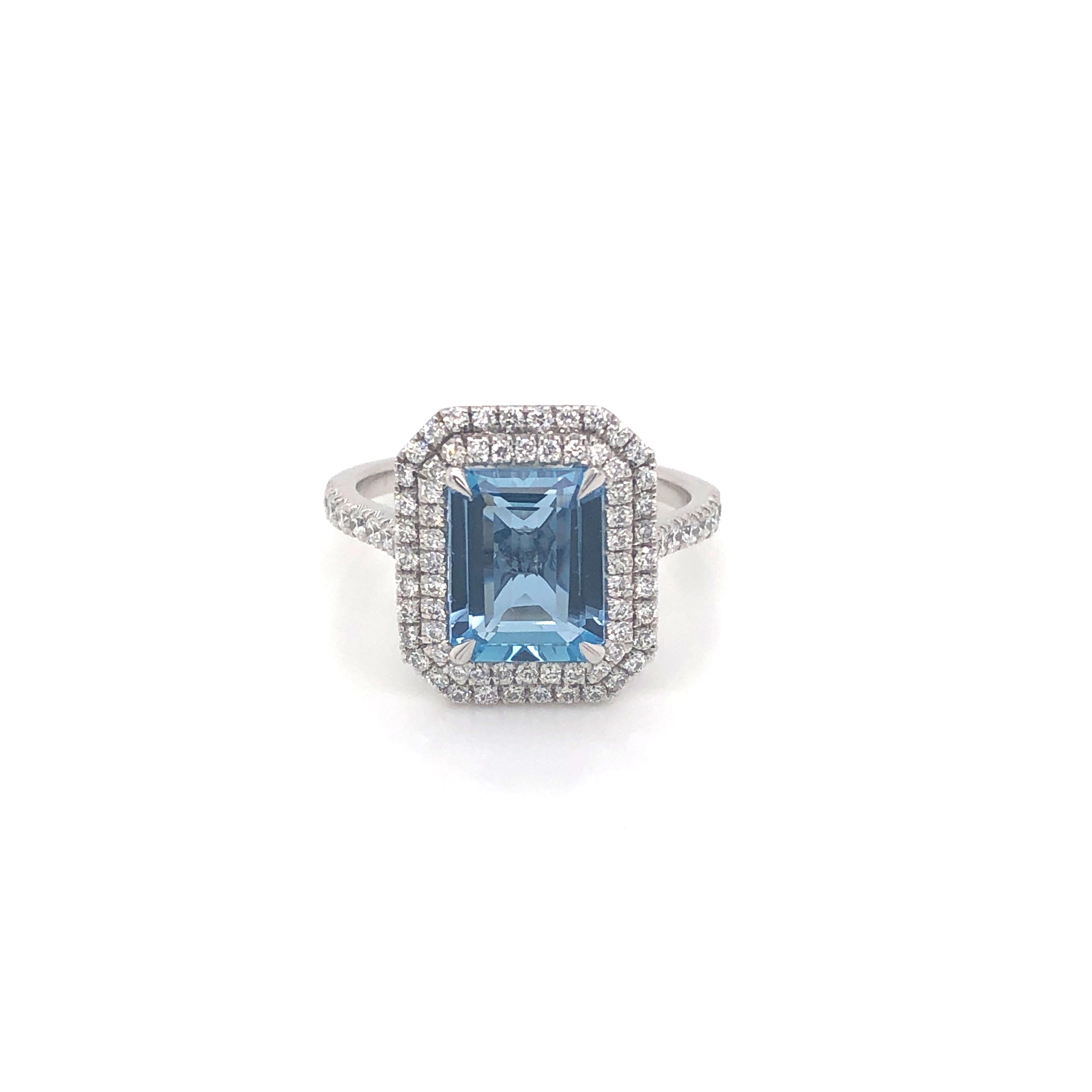 An Aqua Marine and diamond ring with a double Halo.