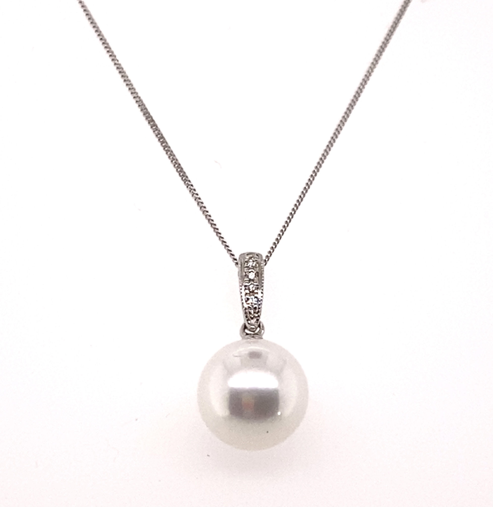A 9 Carat White Gold Cultured Pearl & Diamond Pendant