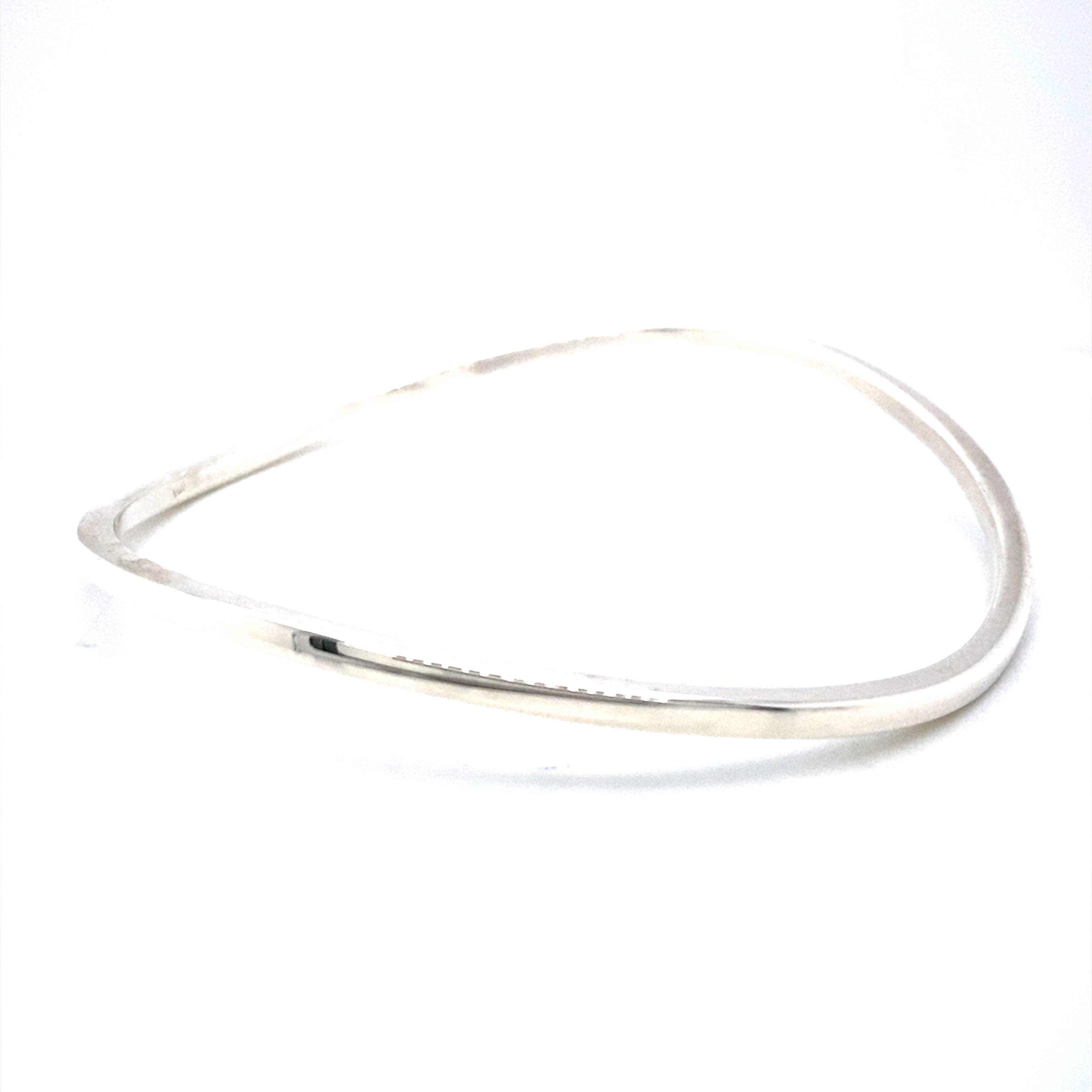 Silver thin curved band bangle